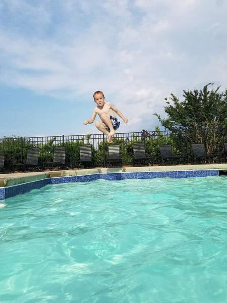 Shirtless Photograph - Full Length Portrait Of Boy Jumping by Amy Dawkins / Eyeem