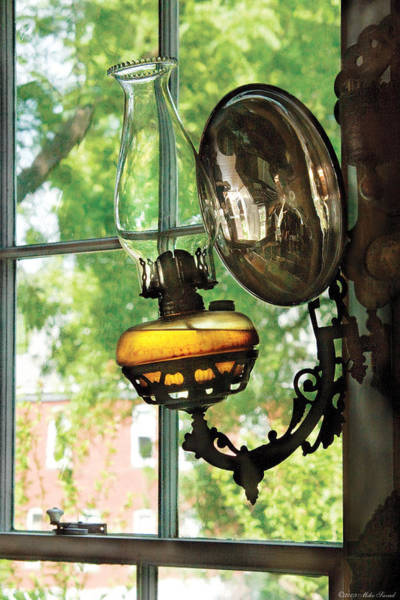 Photograph - Furniture - Lamp - An Oil Lantern by Mike Savad
