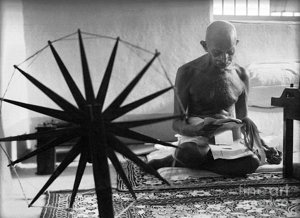 Photograph - Gandhi At His Spinning Wheel by Celestial Images