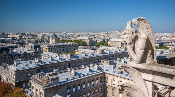 Photograph - Gargoyle Overlooking Paris City From The Top Of Notre Dame Cathedral by Pierre Leclerc Photography
