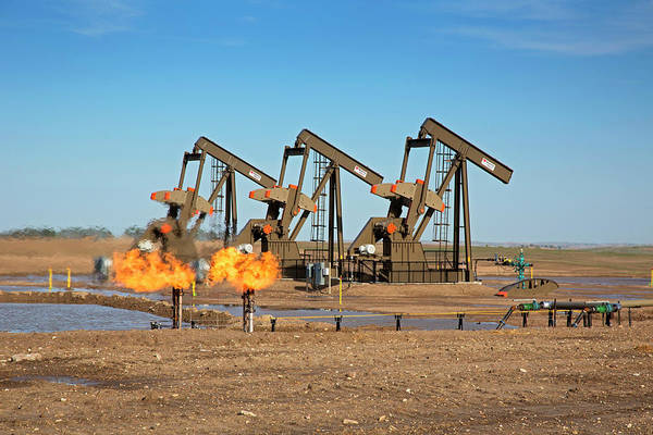 Fossil Fuel Photograph - Gas Flares And Pumps At An Oil Field by Jim West