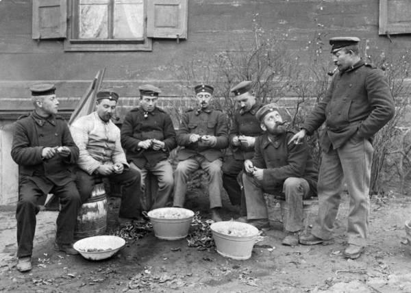 German Food Photograph - Germans Peeling Potatoes by Underwood Archives