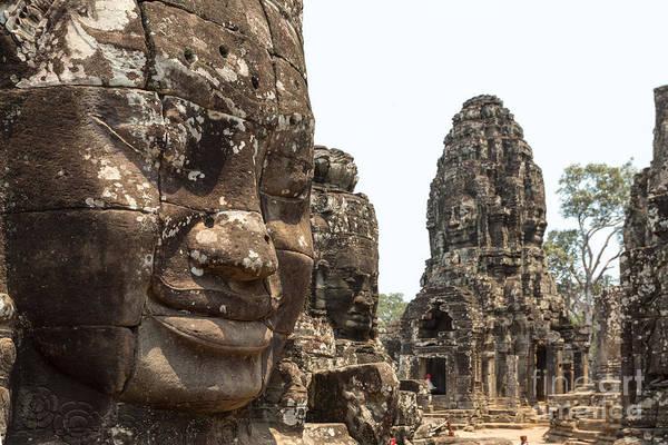 Giant Buddha Photograph - Giant Buddha Faces Inside Bayon Temple - Cambodia by Matteo Colombo