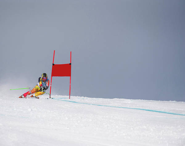 Canada Photograph - Giant Slalom Skier Rounds Gate At High by Ascent Xmedia