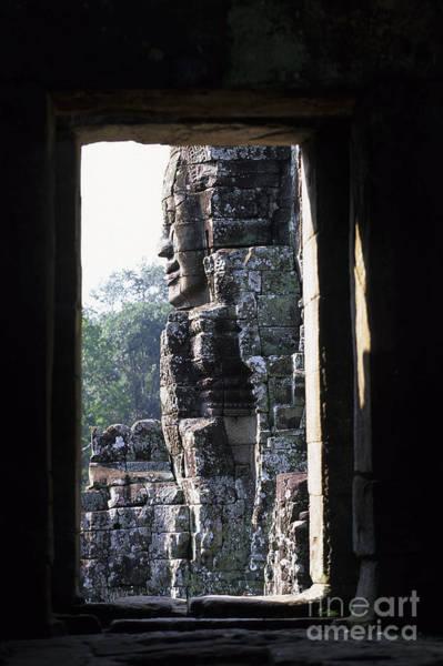 Wall Art - Photograph - Gigantic Face Statues At Khmer Temple Angkor Wat Ruins Cambodia by Ryan Fox