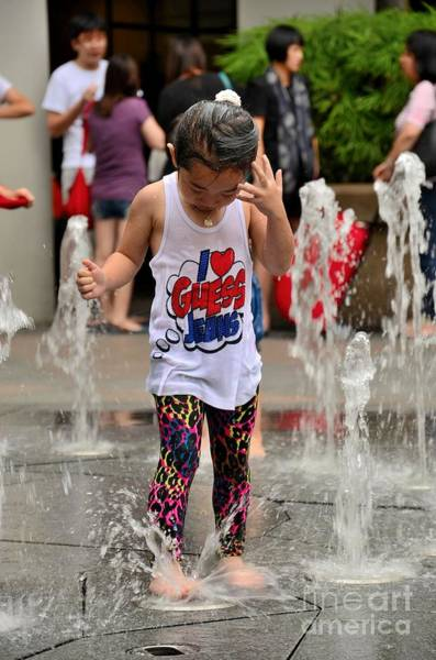 Girl Child Plays With Water At Fountain Singapore Art Print