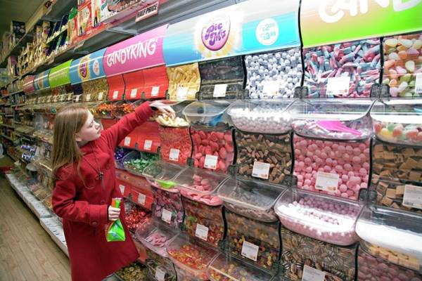Handling Photograph - Girl Choosing Sweets by Mark Thomas/science Photo Library