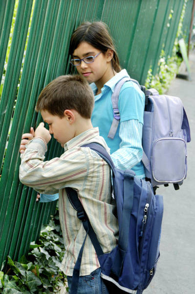 Wall Art - Photograph - Girl Comforting An Unhappy Boy by Aj Photo/science Photo Library