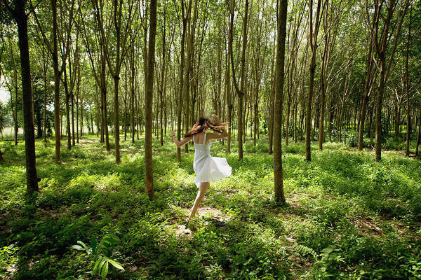 Casual Photograph - Girl Dancing In The Woods by Stuart Corlett / Design Pics