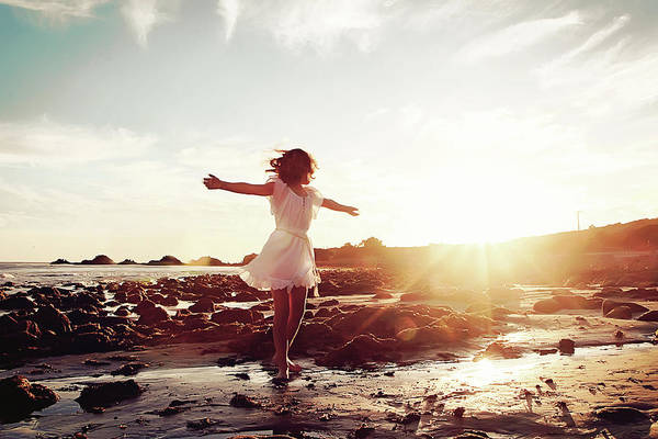 Dress Photograph - Girl Dancing On Beach At Sunset Sun Rays by Dianne Avery Photography