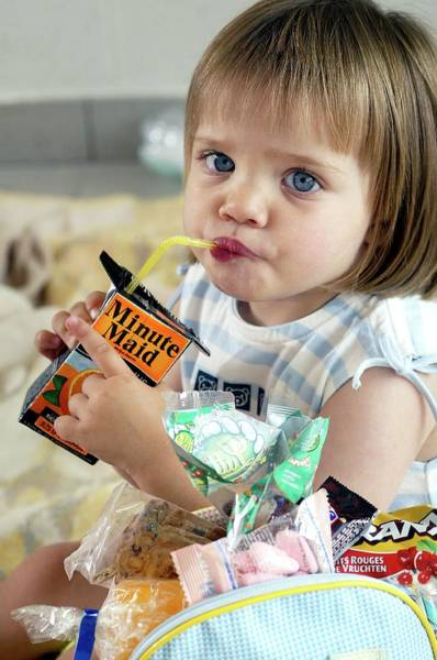 Branding Photograph - Girl Drinking Orange Juice by John Thys/reporters/science Photo Library