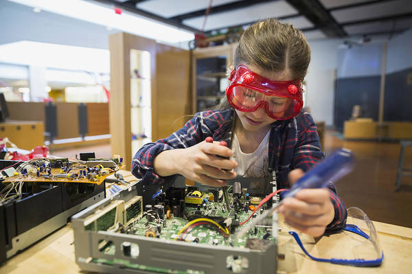 Girl Goggles Assembling Electronics Circuit At Science Center Art Print by Hero Images