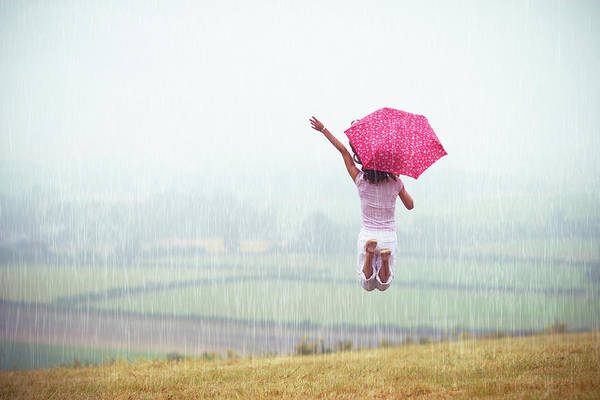 Casual Photograph - Girl Jumping In The Rain by Sasha Bell