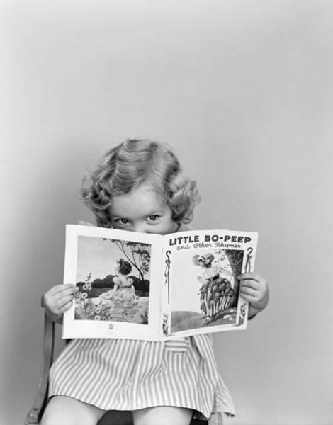 Wall Art - Photograph - Girl Peeking Over Little Bo-peep Book by H. Armstrong Roberts/ClassicStock