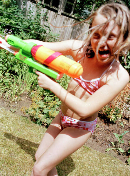 Toy Gun Photograph - Girl Playing by Martin Riedl/science Photo Library