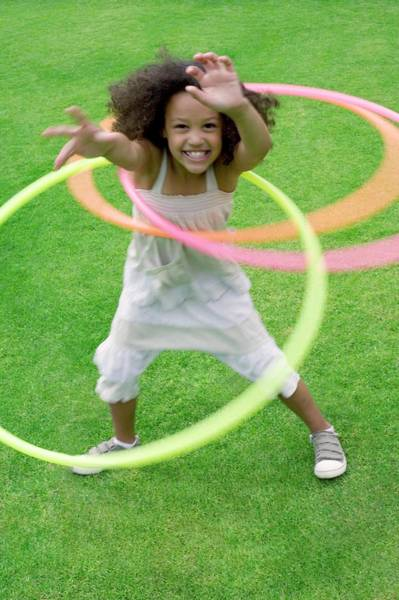 Hula Wall Art - Photograph - Girl Playing With Hula Hoops by Ian Hooton/science Photo Library