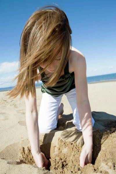 Sensation Photograph - Girl Playing With Sand by Gustoimages/science Photo Library