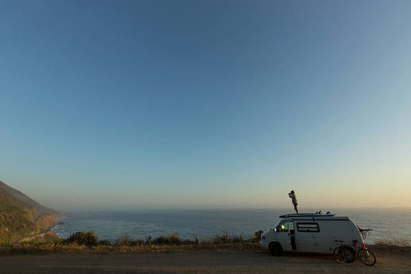 Highway 12 Wall Art - Photograph - Girl Standing On Top Of Camper Van by Woods Wheatcroft