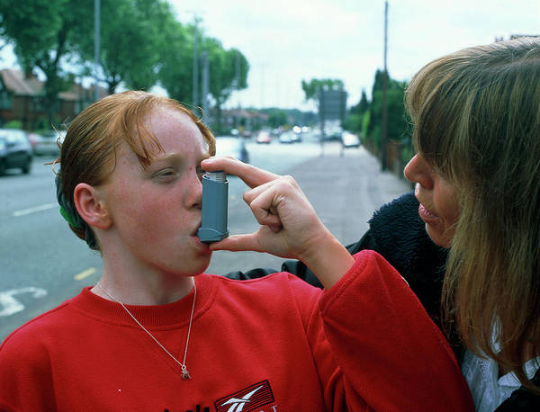 Exhaust Wall Art - Photograph - Girl Uses An Aerosol Inhaler For Asthma by Martin Bond/science Photo Library