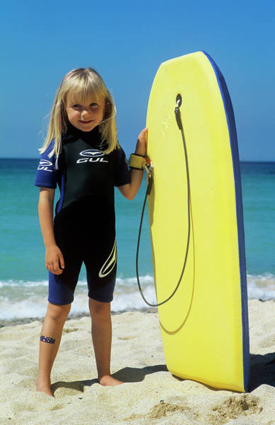 Wetsuit Wall Art - Photograph - Girl With A Surfboard by Ron Sutherland/science Photo Library