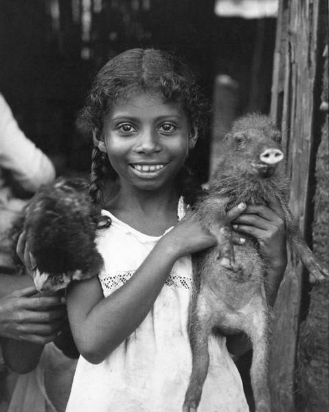 Ugly Photograph - Girl With Pet Peccary by Underwood Archives