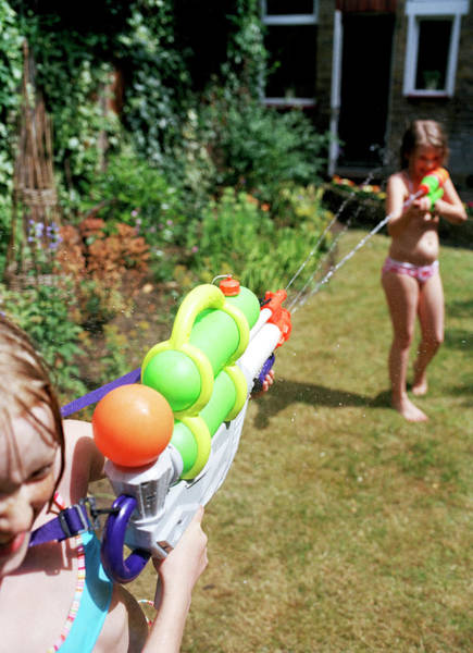 Toy Gun Photograph - Girls Playing by Martin Riedl/science Photo Library