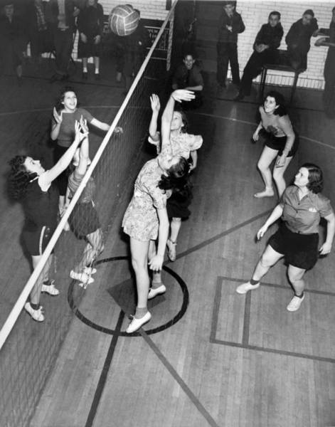 Exertion Wall Art - Photograph - Girls Playing Volleyball by Underwood Archives