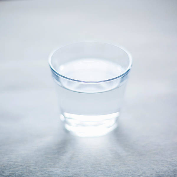 Drinking Glass Photograph - Glass Of Water by Steven Errico