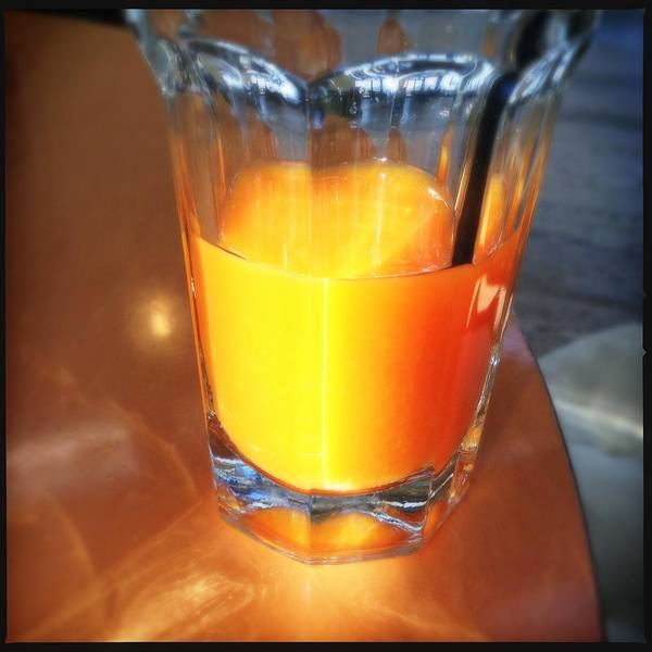 Bright Wall Art - Photograph - Glass With Orange Fruit Juice by Matthias Hauser