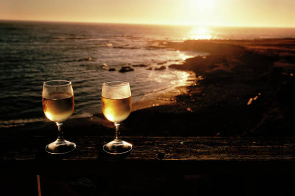 Wall Art - Photograph - Glasses Of White Wine Beside A Beach by Peter Menzel/science Photo Library