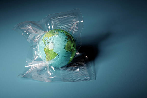 Environmental Issues Photograph - Globe Shrink Wrapped In Plastic by Henrik Weis