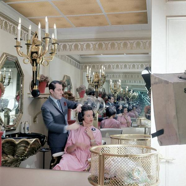 Mirror Photograph - Gloria Vanderbilt At The Revlon Boutique by Horst P. Horst
