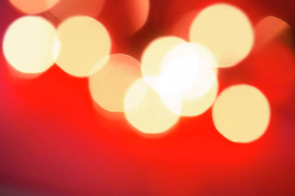 Christmas Lights Photograph - Glowing Light On Red Background, Studio by Tetra Images