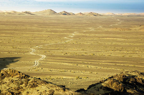 Desolation Photograph - Gobi Desertscape With Road by Ted Wood