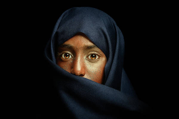 Hiding Photograph - Gold Eyes by Fathi Aldarwish