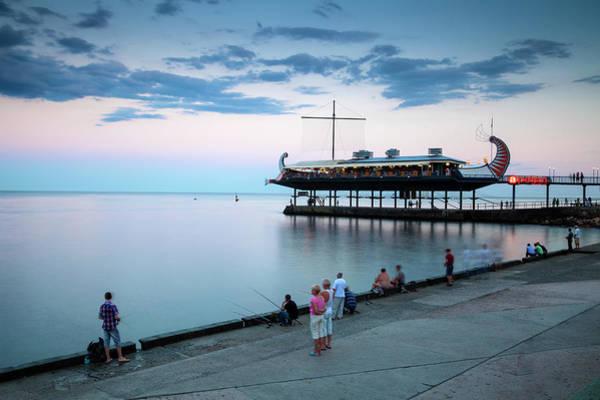 Canoe Photograph - Golden Fleece Restaurant Over Yalta Bay by Jane Sweeney