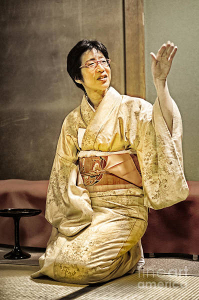 Photograph - Golden Glow - Japanese Lady In Traditional Kimono Explains The Tea Ceremony by David Hill