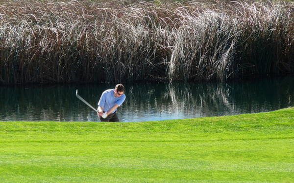 Photograph - Golfer Swing Water Hazard by Jeff Lowe