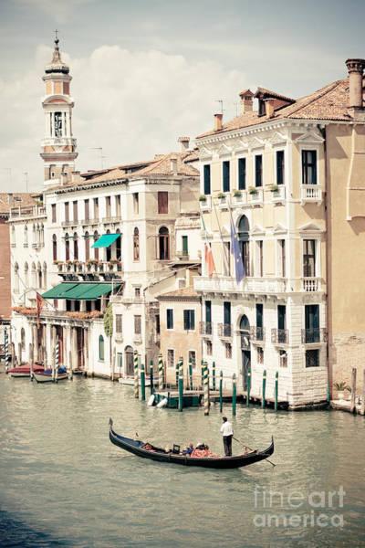 Photograph - Gondola On The Grand Canal By Rialto Bridge In Venice Italy By Raimond Klavins by Raimond Klavins