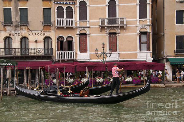 Lion Of St Mark Photograph - Gondolier On The Grand Canal by Brenda Kean