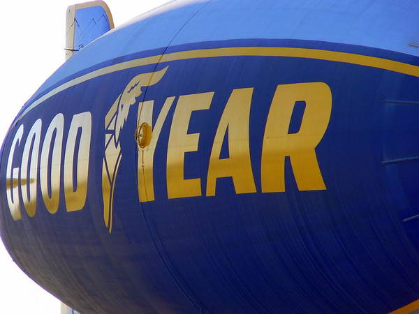 Photograph - Goodyear Blimp Side by Jeff Lowe