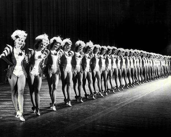 Radio City Music Hall Photograph - Gorgeous Rockettes Pose For Picture On Stage by Retro Images Archive