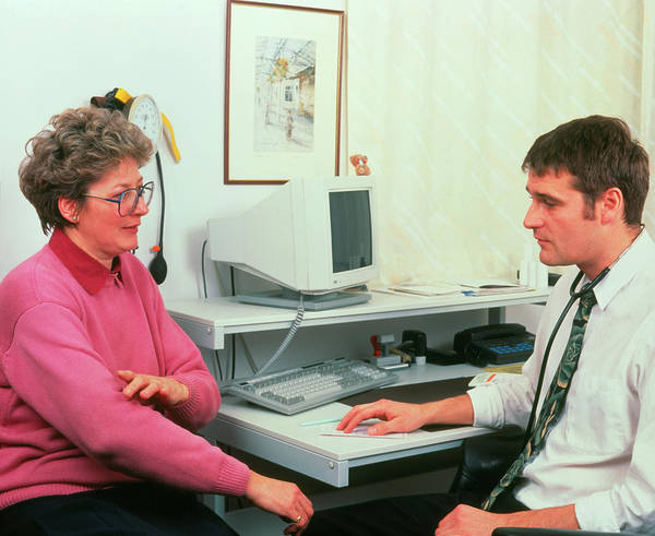 Patient Photograph - Gp Doctor In Consultation With A Woman Patient by Simon Fraser/science Photo Library