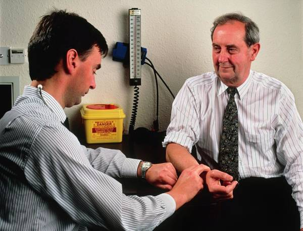 Pulse Photograph - Gp Doctor Measures Pulse Of Elderly Man by Saturn Stills/science Photo Library