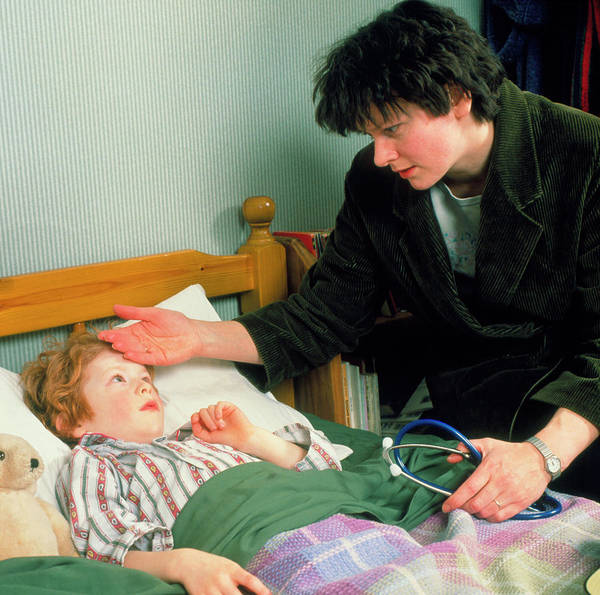 Fever Photograph - Gp Doctor On Home Visit Examines Feverish Child by Chris Priest/science Photo Library