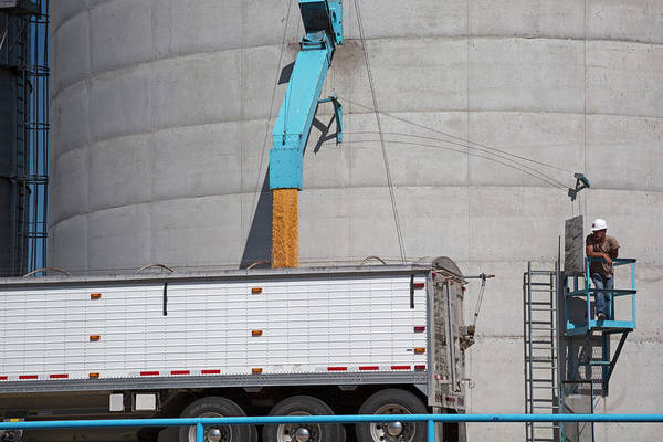 Grain Elevator Photograph - Grain Truck Being Filled At A Silo by Jim West