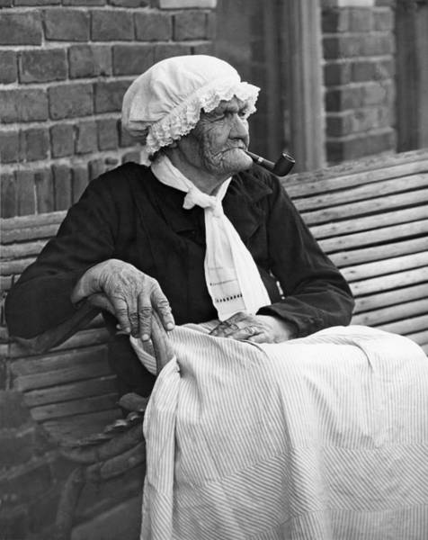 Crone Wall Art - Photograph - Grandma Smokes Pipe At Age 92 by Underwood Archives