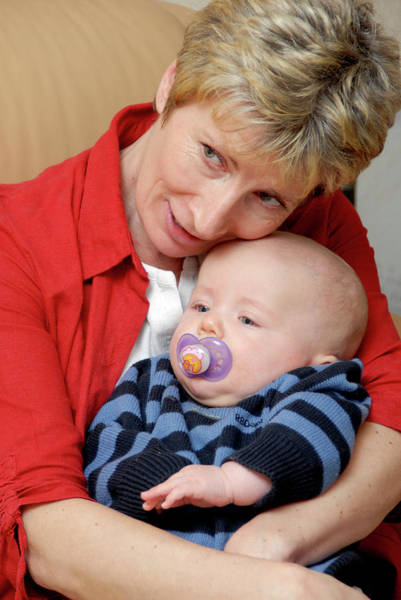 Cuddle Photograph - Grandmother And Baby by Aj Photo/science Photo Library
