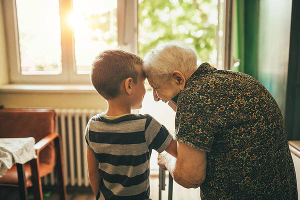 Grandson Visiting His Granny In Nursery Art Print by Supersizer
