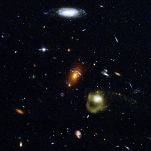 Wall Art - Photograph - Gravitational Lensing Between Galaxies by Nasa/esa/stsci/j.blakeslee & H.ford, Jhu/ Science Photo Library